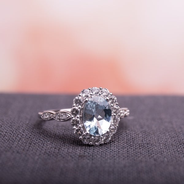 Miadora 14k White Gold Oval-cut Aquamarine White Topaz and Diamond Accent Halo Engagement Ring. Opens flyout.