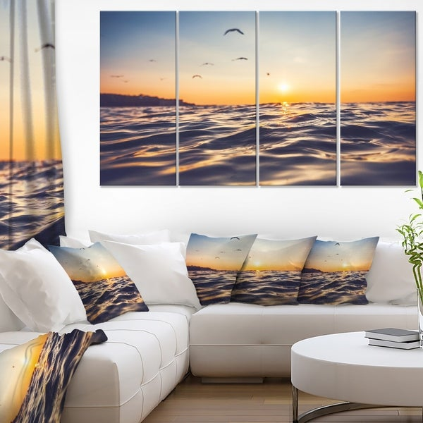 Orange Tinged Sea Waters at Sunrise - Beach Canvas Wall Art
