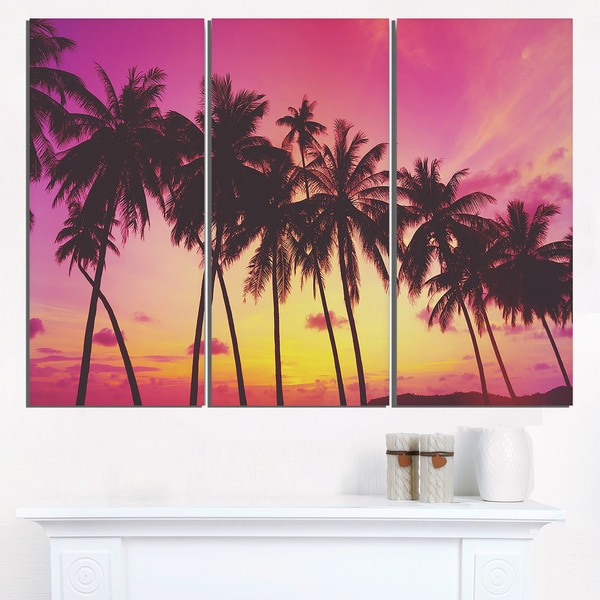 row of beautiful palms under magenta sky extra large wall art
