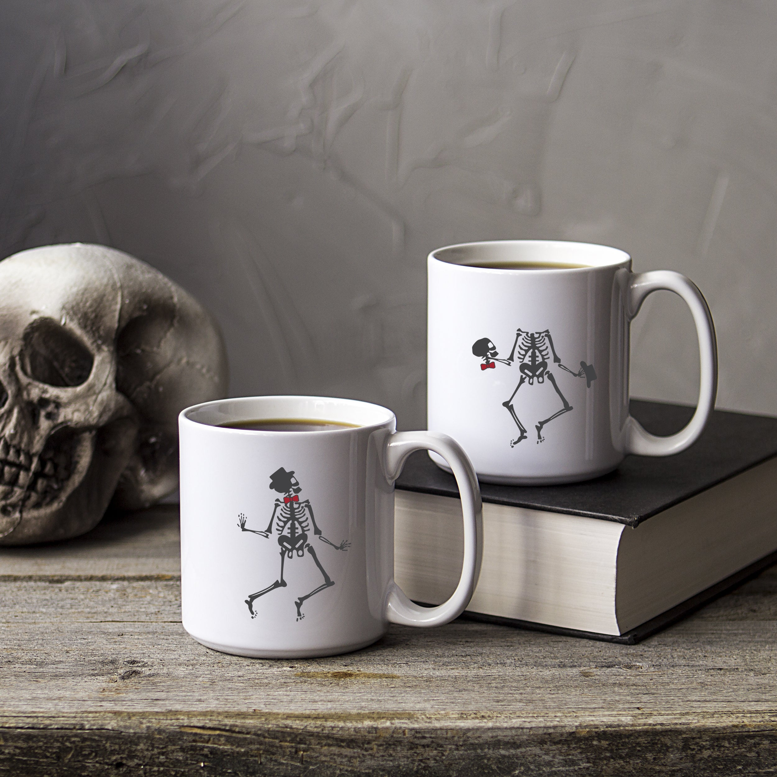 Cathy's Concepts Set of 2 White Ceramic Dancing Skeletons...