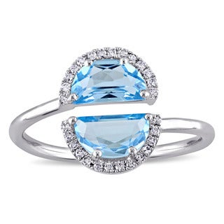 Miadora Signature Collection 14k White Gold Blue Topaz and 1/10ct TDW Diamond Bypass Ring (G-H, SI1-SI2)