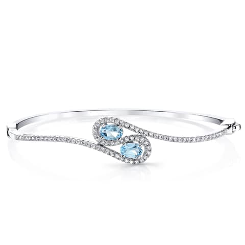 Oravo 1-carat Swiss Blue Topaz Sterling Silver Infinity Bangle Bracelet