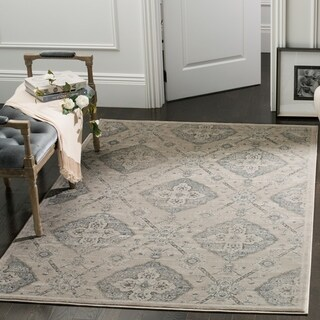 Safavieh Carnegie Vintage Taupe / Light Blue Rug (7' x 10')
