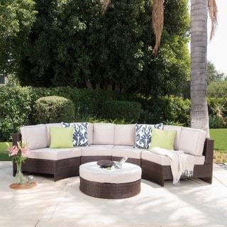 Link to Madras Tortuga Outdoor 4-seat Round Wicker Chat Set with Ottoman by Christopher Knight Home Similar Items in Patio Sets