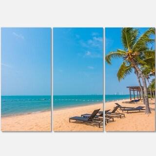 Designart - Blue Beach with Palm Trees - Seashore Photo Glossy Metal Wall Art