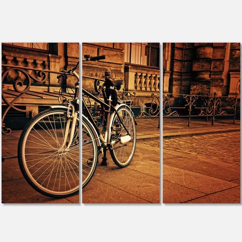 Designart - Retro Bicycle against Stone Wall - Landscape Photo Glossy Metal Wall Art - 36 in. wide x 28 in. high - 3 panels