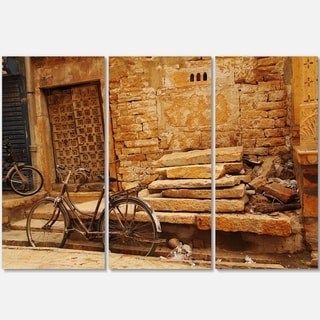Designart - Bicycle against Brown Wall - Landscape Photo Glossy Metal Wall Art