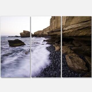 Designart - Rolling Stones at Beach - Seashore Photo Glossy Metal Wall Art