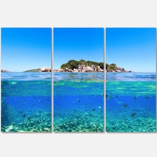 Designart - Under and Above the Waters - Seascape Photo Glossy Metal Wall Art - 36 in. wide x 28 in. high - 3 panels