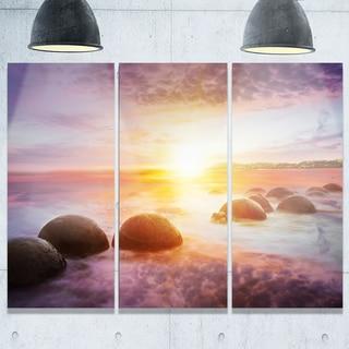 Designart - Evening Sun Over Moeraki Boulders - Seashore Photo Glossy Metal Wall Art