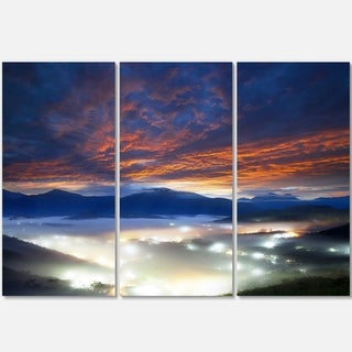 Designart - Fiery Clouds and Lit-up Villages - Landscape Photo Glossy Metal Wall Art