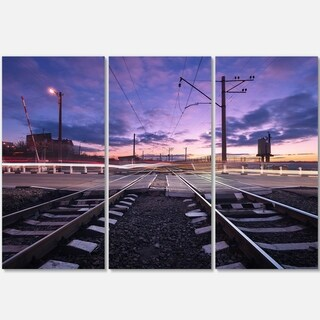 Designart - Rail Crossing with Blurred Car Lights - Cityscape Photo Glossy Metal Wall Art