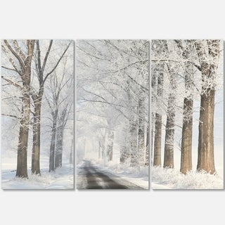 Designart - Road Through Frosted Forest - Landscape Photo Glossy Metal Wall Art