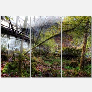Designart - Creek and Bridge with Sunbeams - Landscape Photo Glossy Metal Wall Art