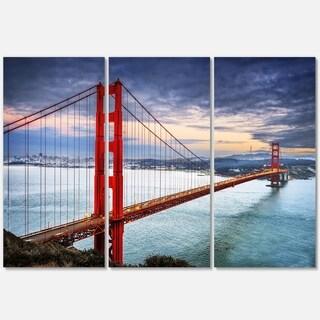 Designart - Golden Gate under Cloudy Sky - Sea Bridge Glossy Metal Wall Art