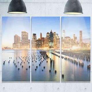 Designart - Illuminated New York Skyscrapers - Cityscape Glossy Metal Wall Art