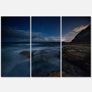 Designart - Rocky Blue Ocean at Nighttime - Large Seashore Glossy Metal Wall Art