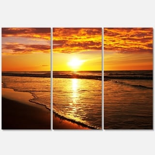 Designart - Bright Yellow Sunset over Waves - Modern Beach Glossy Metal Wall Art
