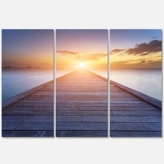 Designart - Wooden Pier to Bright Evening Sun - Sea Bridge Glossy Metal Wall Art