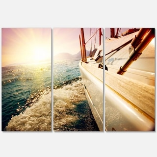 Designart - Huge Yacht Sailing Against Sunset - Sea Pier Glossy Metal Wall Art