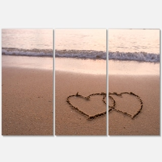 Designart - Two Hearts Drawn on the Beach - Extra Large Seascape Glossy Metal Wall Art