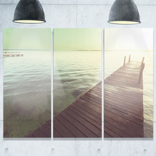 Designart - Wooden Boardwalk over Clear Waters - Large Sea Bridge Glossy Metal Wall Art