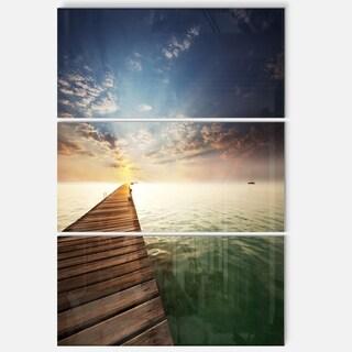 Designart - Wooden Boardwalk into Indefinite Sea - Large Sea Bridge Glossy Metal Wall Art