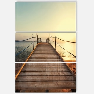 Designart - Strong Wooden Boardwalk into Sea - Large Sea Bridge Glossy Metal Wall Art