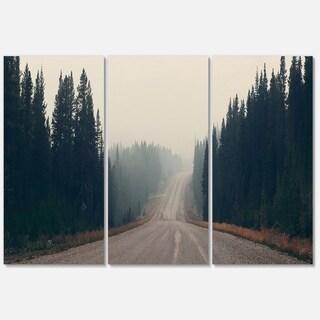 Designart - Foggy Road in Forest in Banff Park - Modern Seascape Glossy Metal Wall Art