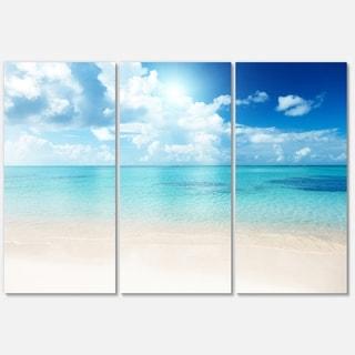 Designart - Sand of Beach in Blue Caribbean Sea - Modern Seascape Glossy Metal Wall Art