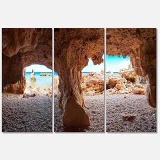 Designart - Denia Las rotas Beach Caves - Landscape Glossy Metal Wall Art