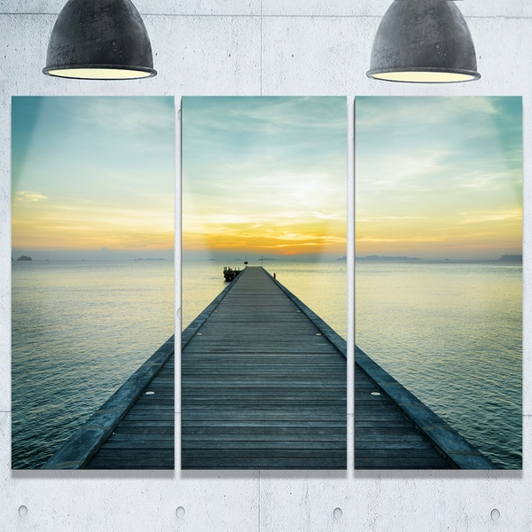 Designart - Wood Pier into the Yellow Blue Sea - Wooden Sea Bridge Glossy Metal Wall Art