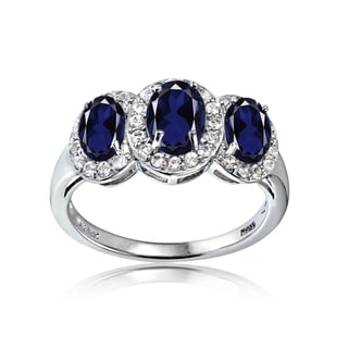 Glitzy Rocks Sterling Silver Created Sapphire and White Topaz 3-Stone Halo Ring