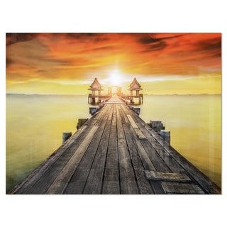 Huge Wooden Pier into Yellow Sun - Sea Pier and Bridge Glossy Metal Wall Art