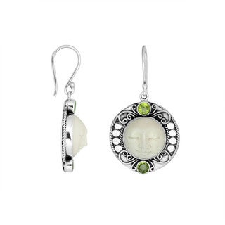 Handmade Sterling Silver Carved Bone Face with Peridot Dangle Earrings (Indonesia)