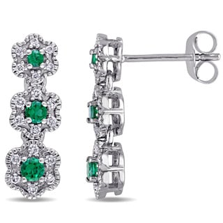 Laura Ashley 10k White Gold Created Emerald and 1/5ct TDW Diamond Triple Flower Graduated Earrings (G-H, I2-I3)