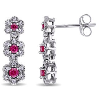 Laura Ashley 10k White Gold Created Ruby and 1/5ct TDW Diamond Triple Flower Graduated Earrings (G-H, I2-I3)