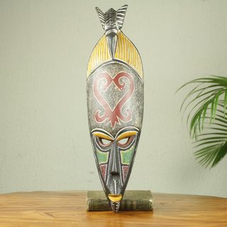 Handcrafted Sese Wood 'Return and Get It' African Wall Mask (Ghana)