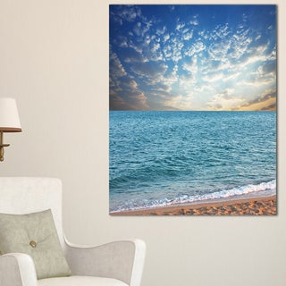Fasting Moving Clouds Over Blue Beach - Modern Beach Canvas Art Print