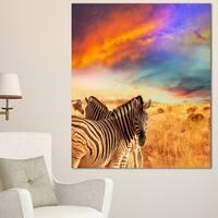 Designart 'Zebras in Bush under Colorful Sky' African Canvas Artwork