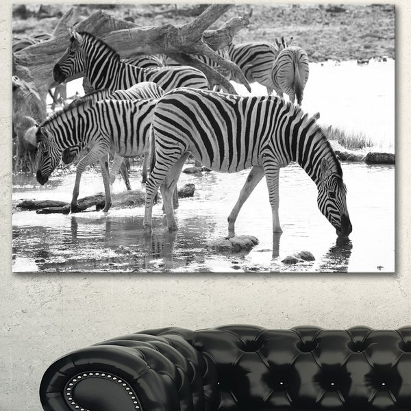 Designart herd of zebra black and white african canvas