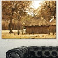 Designart 'Beautiful Rural African Huts' Oversized Landscape Canvas Art - Green