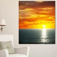Designart 'Fantastic Sunset over Sea Waters' Large Seashore Canvas Print