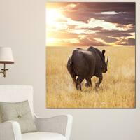 Designart 'Giant Rhino under Bright Sky' African Wall Art Print