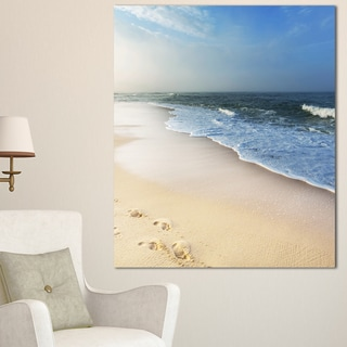Designart 'Clam Tropical Beach with Footprints' Large Seashore Canvas Print