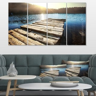 Designart 'Large Wooden Pier into the Lake' Large Seashore Canvas Art - Blue
