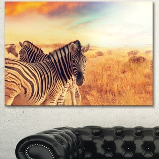 Designart 'Zebras Herd in Field At Sunset' Extra Large African Art Print
