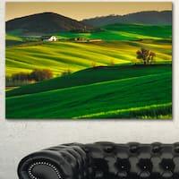 Designart 'Trees and Farmland Near Volterra' Extra Large Landscape Canvas Art - Green