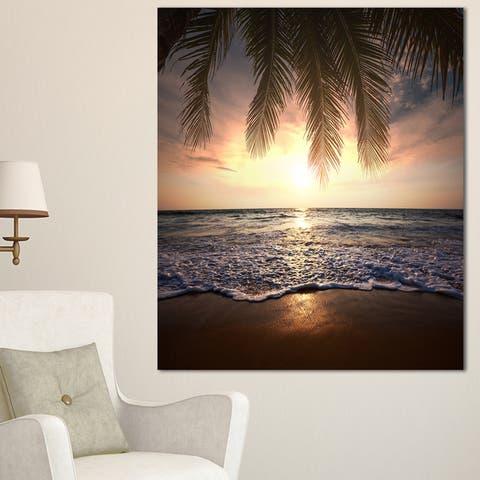 Designart 'Tropical Beach with Palm Leaves' Seashore Wall Art Print