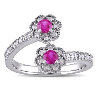 Laura Ashley 10k White Gold Created Ruby and 1/5ct TDW Diamond Double Flower Bypass Ring (G-H, I2-I3)